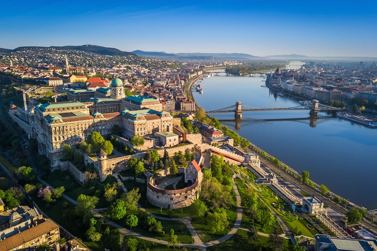 Beautiful aerial skyline view of Buda Castle Royal Palace and South Rondella at sunset with Szechenyi Chain Bridge over Danube River