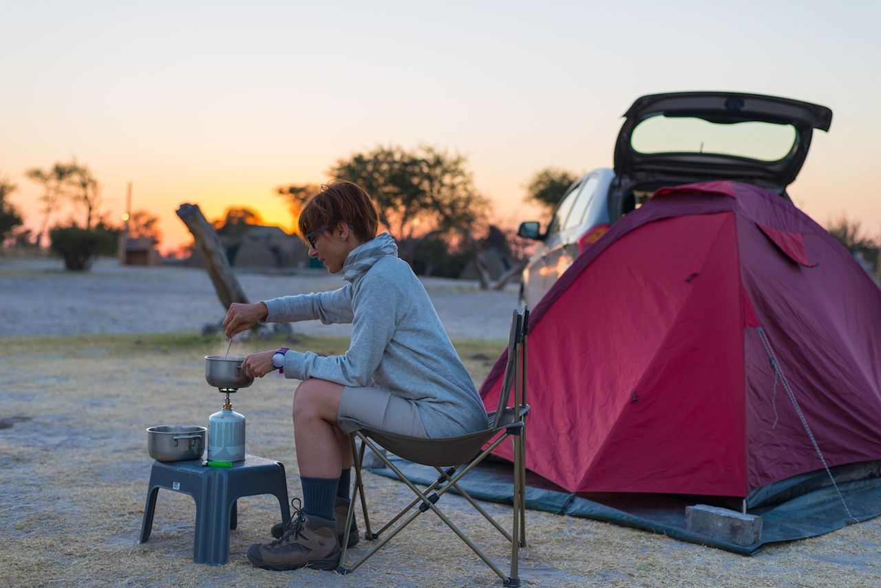 Woman with camping tent